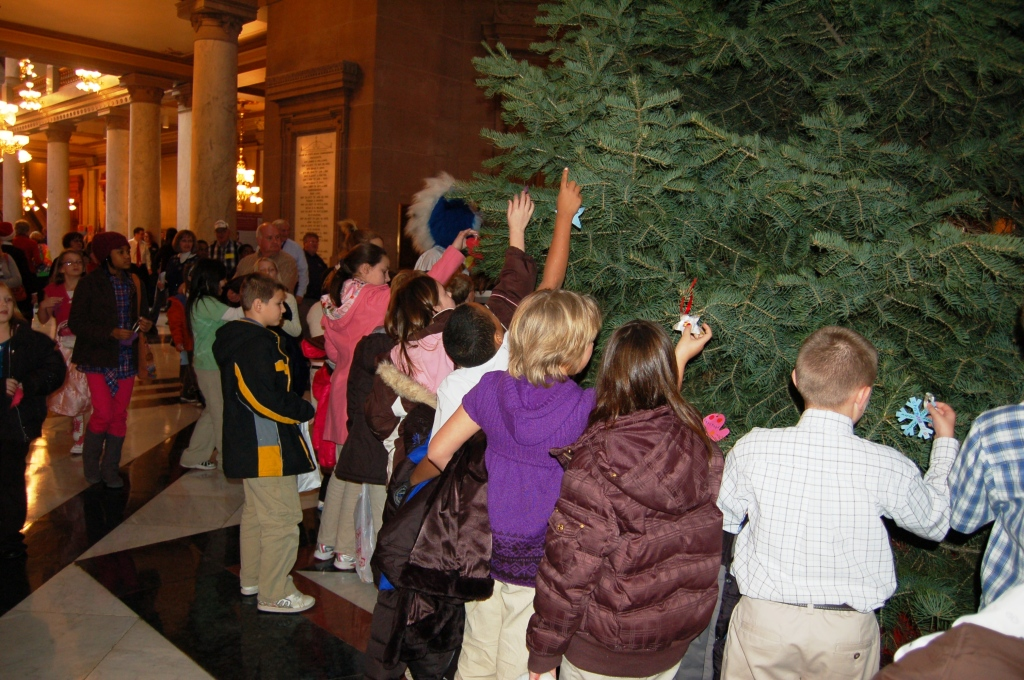 Students decorate the tree