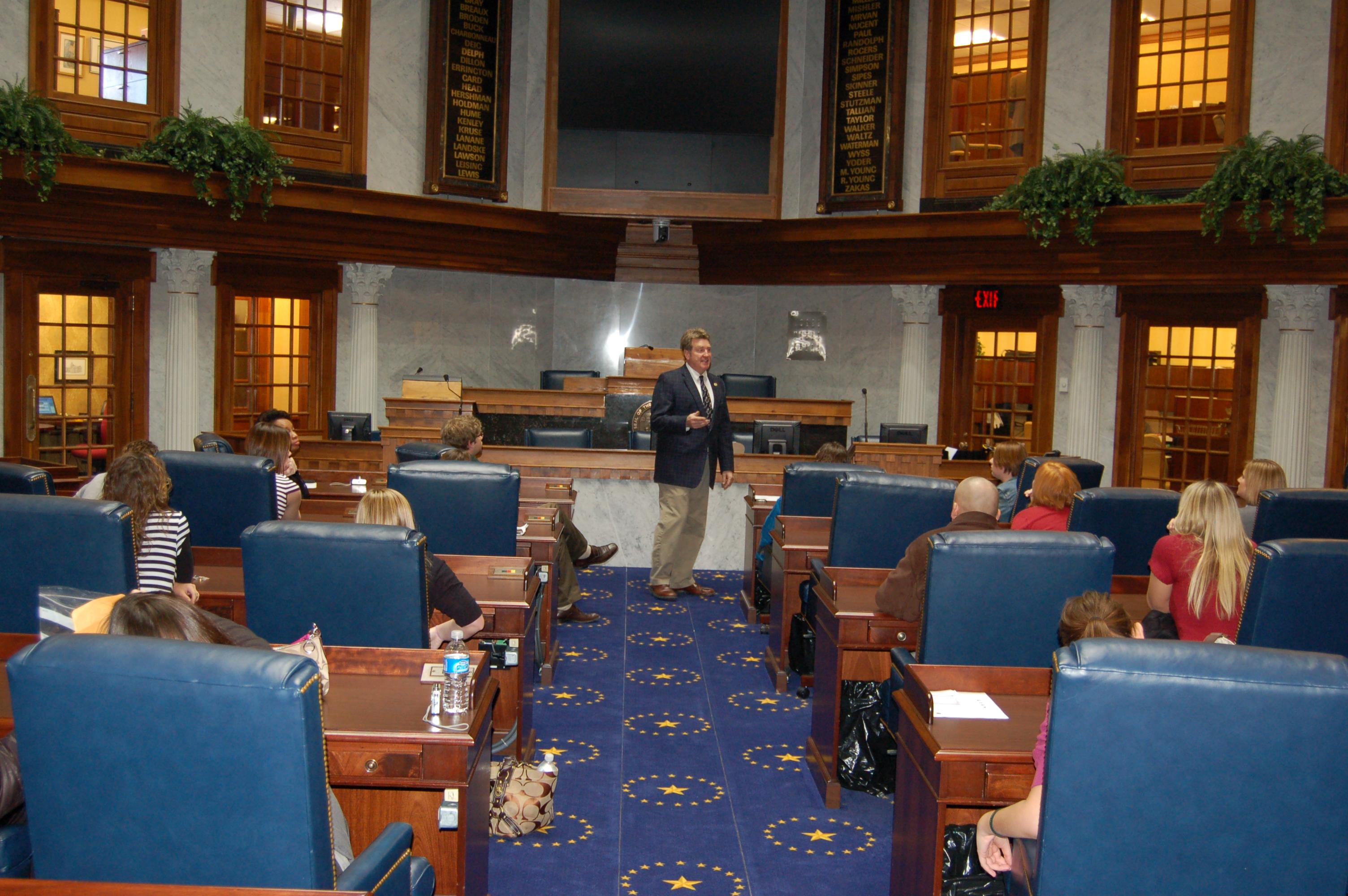 Senator Deig speaks with students in the Senate chamber.