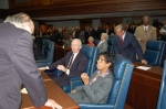 Sen. Lindel Hume and Sen. Earline Rogers talk with colleagues in the Senate chamber.