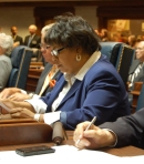 Sen. Jean Breaux working at her desk during Organization Day.