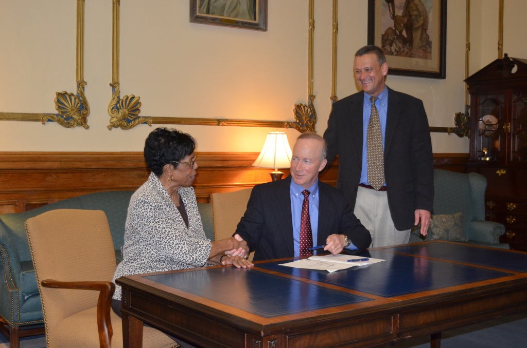 Sen. Rogers with governor signing Erin's Law