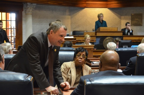 Sen. Stoops and Sen. Rogers speak with Sen. Taylor during session.